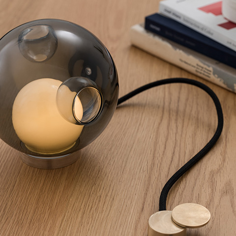 interior space featuring bocci 28t table lamp on wood desk