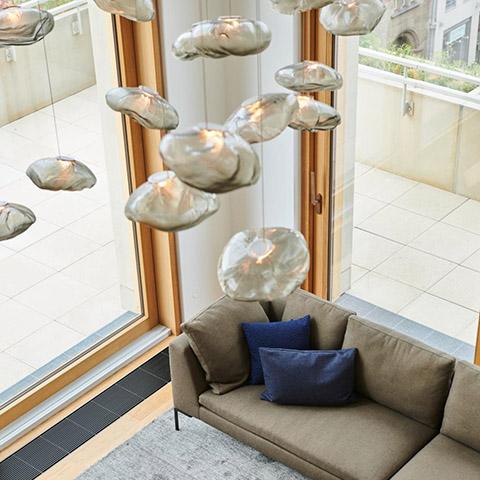 modern living room featuring bocci 73 pendant lights