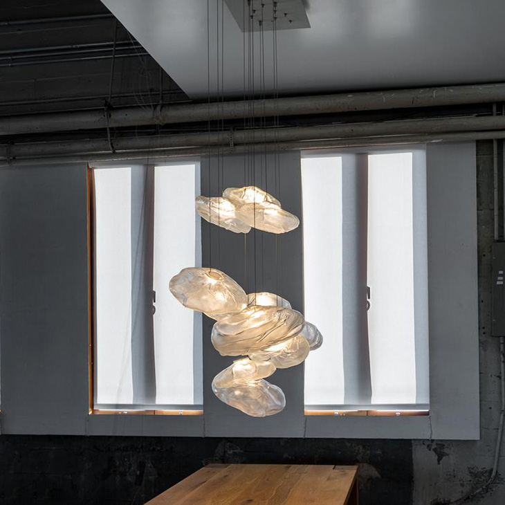 dining room featuring bocci 73 pendant light
