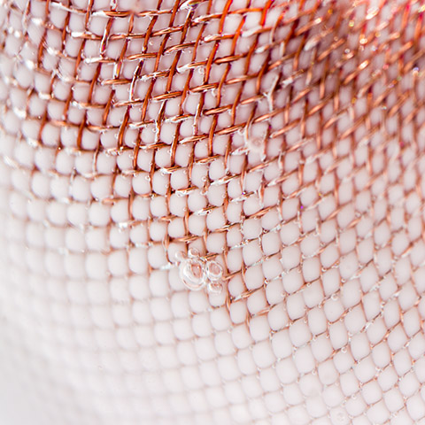 close up of bocci 84 series glass and copper mesh sphere