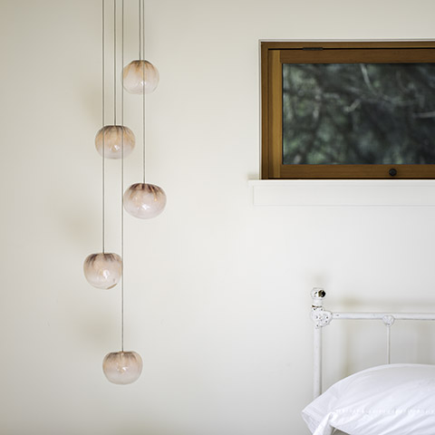 bedroom featuring bocci 84 series pendant light
