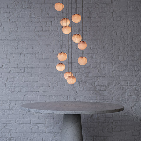foyer featuring 84 series pendant lights hanging over round marble table