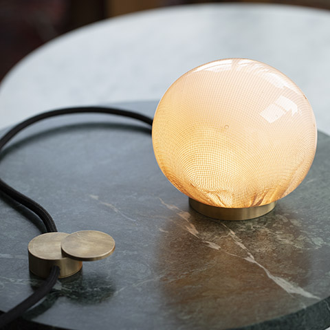 close up of bocci 73t table lamp on marble table