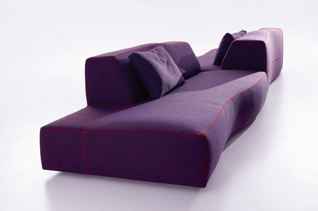 b&b italia bend sofa on a grey background