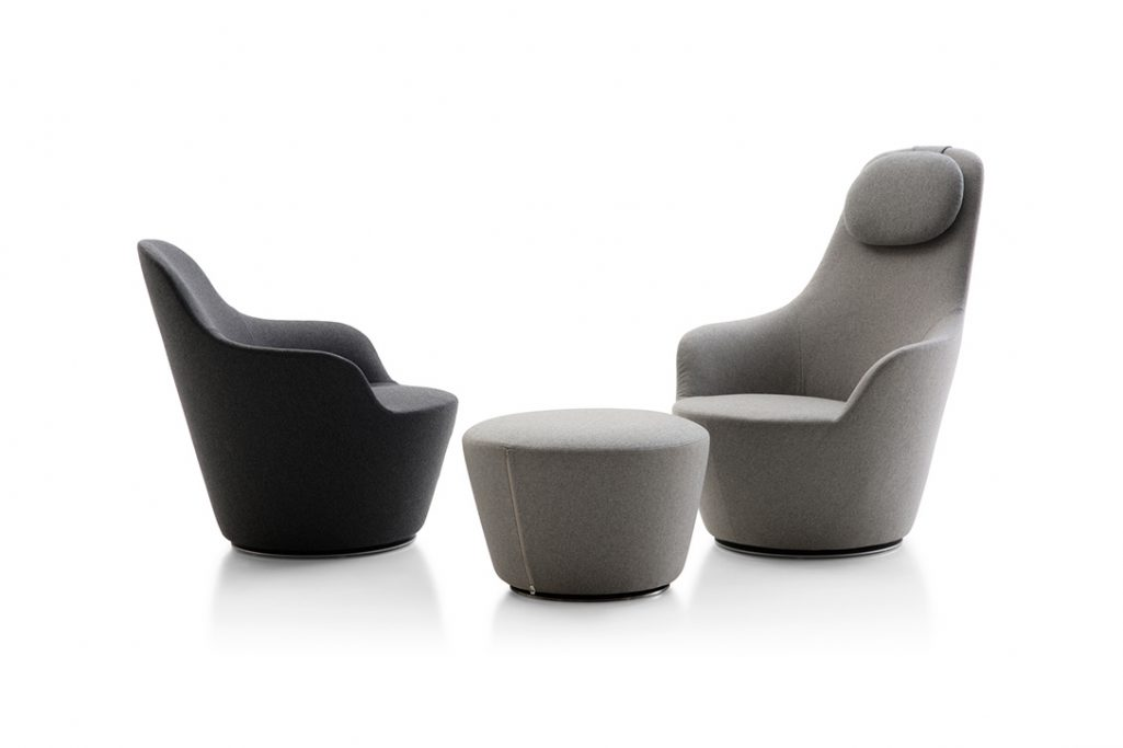 b&b italia low back and high back harbor armchairs and a harbor ottoman on a white background