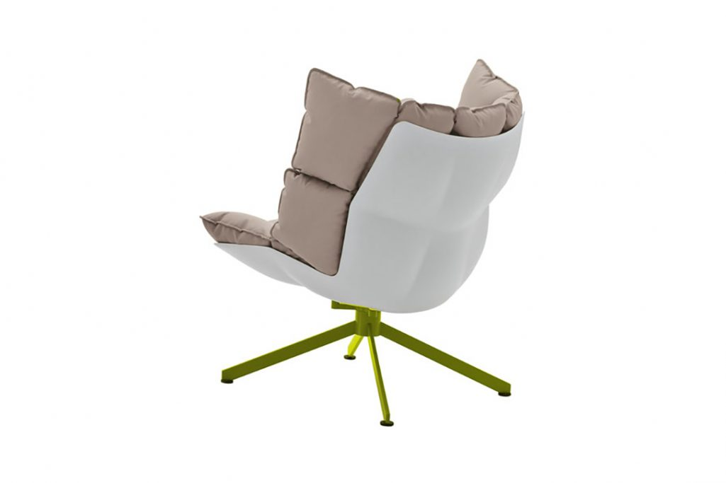 b&b italia husk armchair with white shell and acid green metal base on a white background