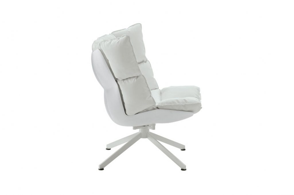 b&b italia husk armchair with white shell and white metal base on a white background