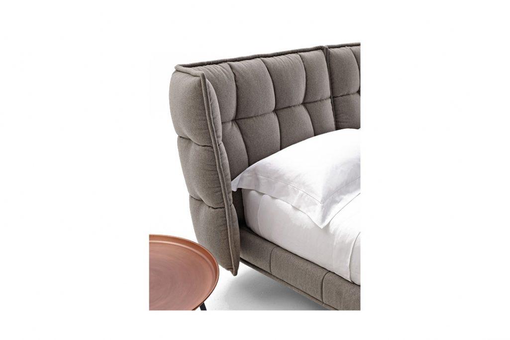 detail of b&b italia husk bed on white background