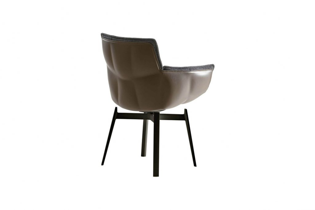 back of a b&b italia husk chair with metal base on a white background