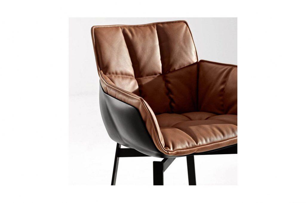 b&b italia husk chair with metal base on a grey background