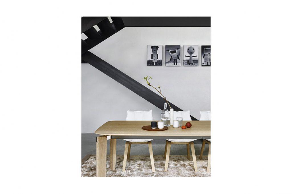 modern dining room featuring b&b italia husk chairs with oak wood base