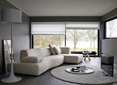 living room featuring b&b italia bend sofa in cream fabric