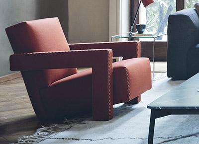 living room featuring cassina utrecht armchair
