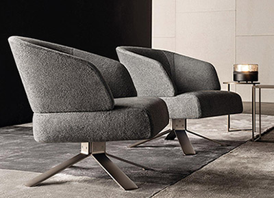 living room featuring a pair of minotti reeves armchairs