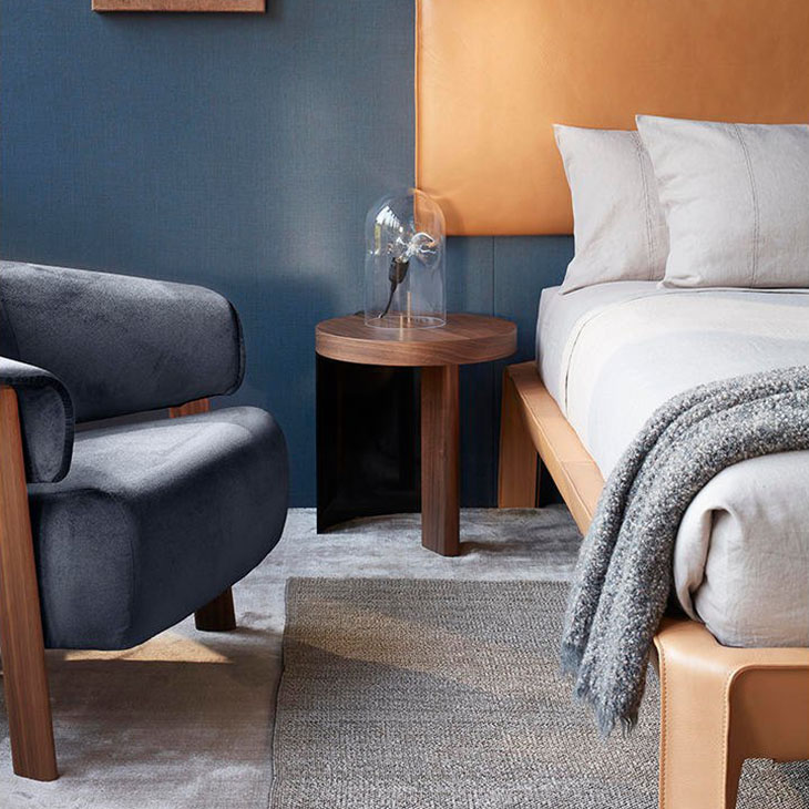 modern bedroom featuring cassina back-wing armchair chair