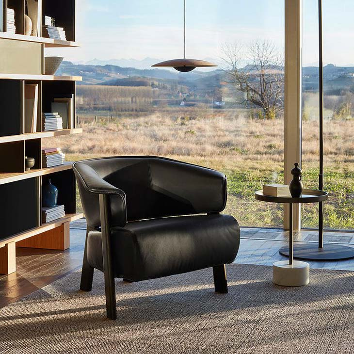 modern living room featuring cassina back-wing armchair chair