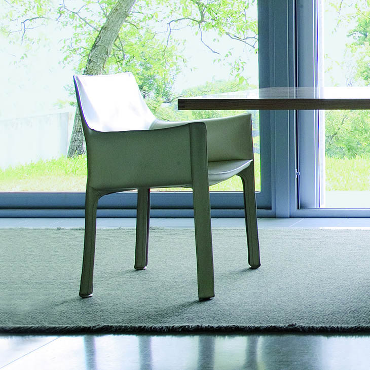 modern dining room featuring cassina cab dining arm chair