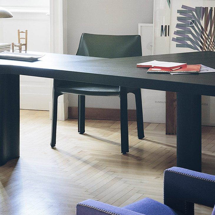 modern home office featuring cassina ventaglio table and cab dining arm chair