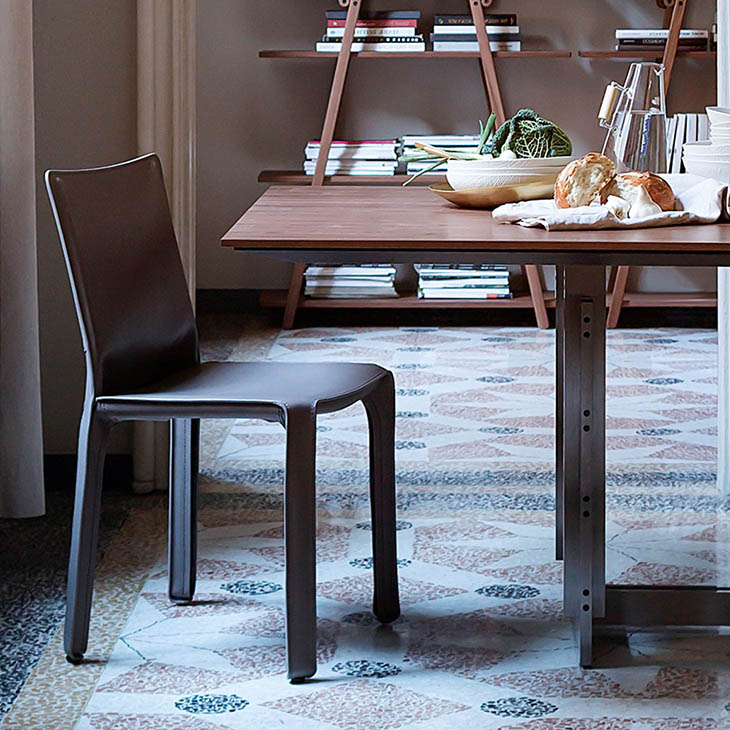 modern dining room featuring cassina cab dining chair