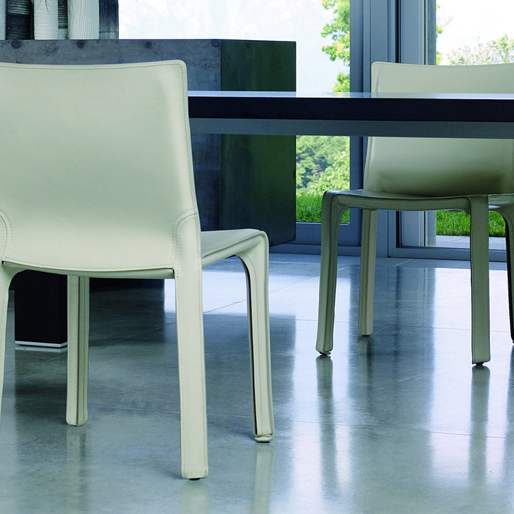 modern dining room featuring cassina cab dining chairs