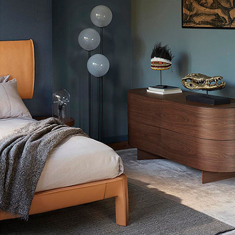 modern bedroom featuring cassina cab night bed by mario bellini