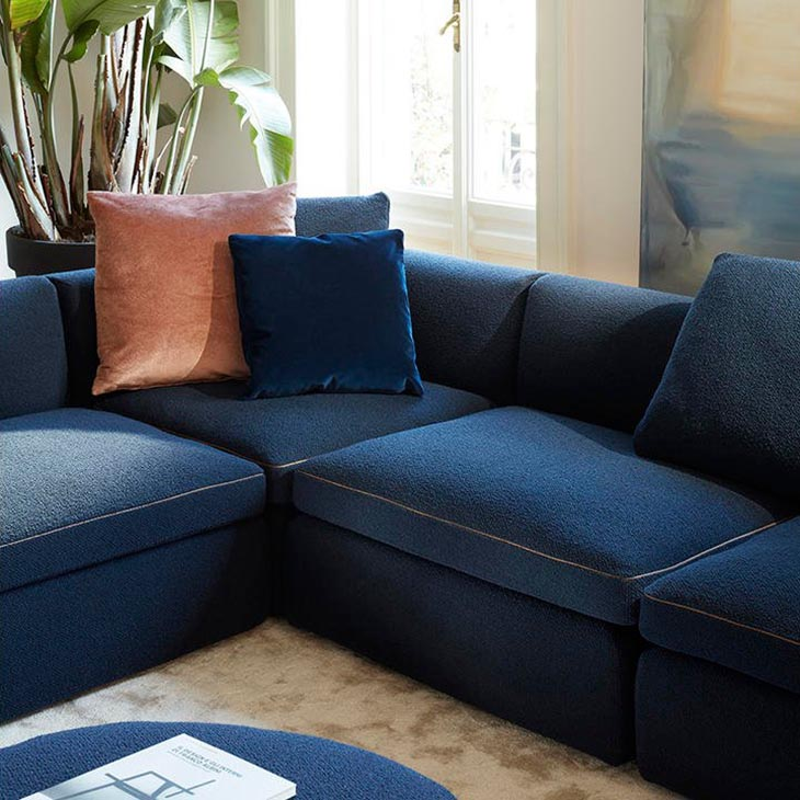 modern living room featuring cassina dress-up sectional chaise left