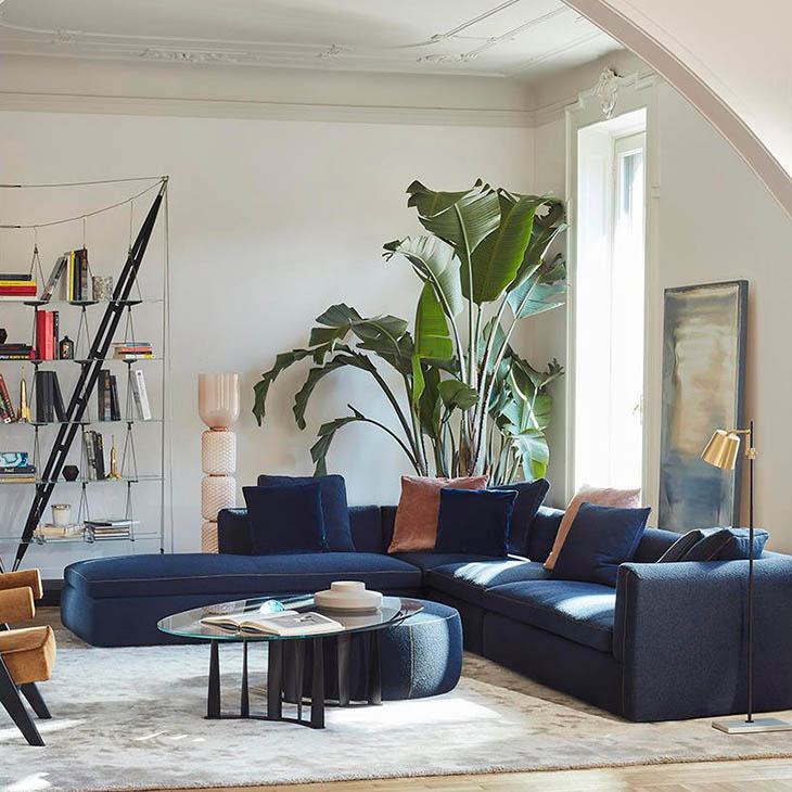 modern living room featuring cassina dress-up sectional chaise left with ottoman