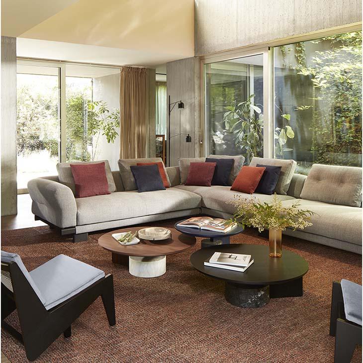 modern living room featuring cassina kangaroo chairs