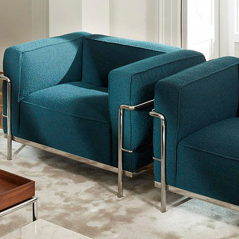 living room featuring two cassina lc3 fauteuil grand confort durable armchairs