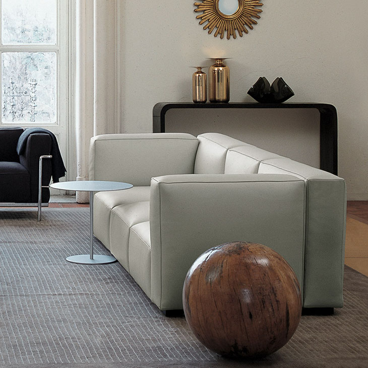 modern living room featuring white leather cassina mex cube sofa