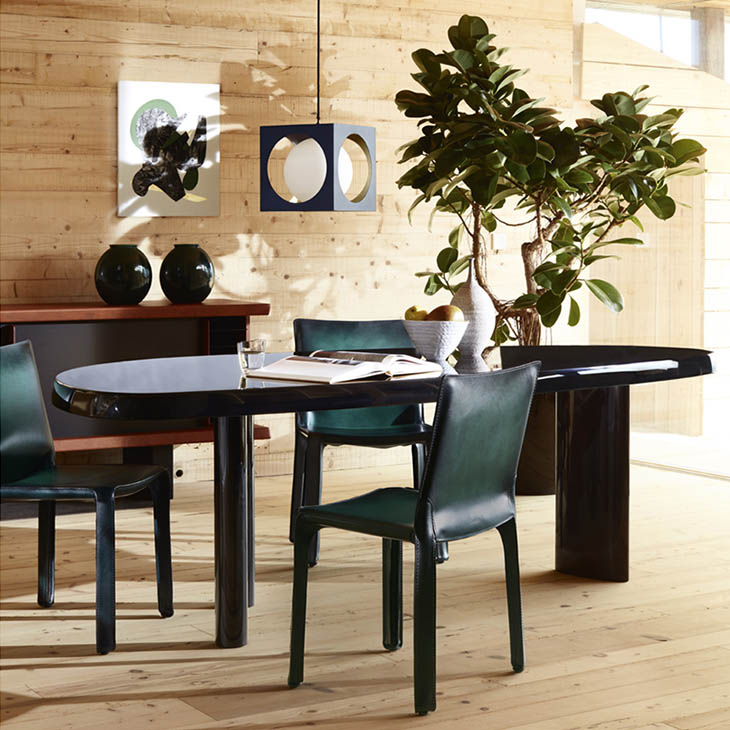 modern dining room featuring cassina table en forme libre and cab chairs