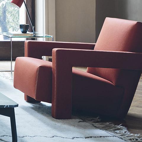 modern living room featuring cassina utrecht armchair