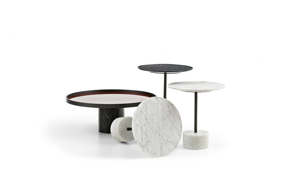 four cassina 9 tables on a white background