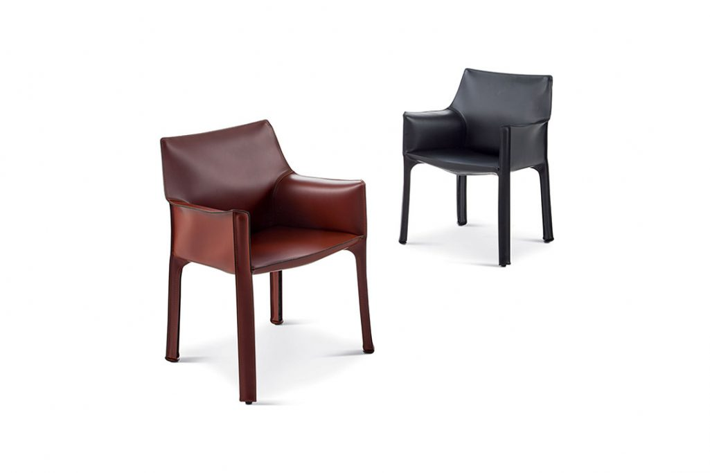 two cassina cab dining arm chairs