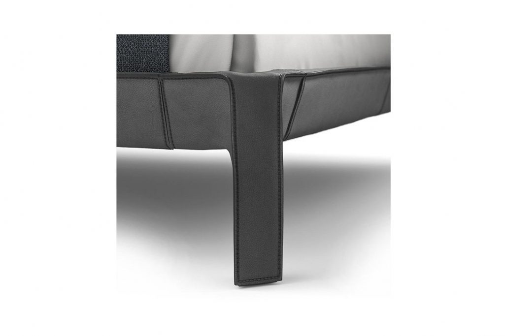 detail of leather and stitching on the leg of a cassina cab night bed by mario bellini
