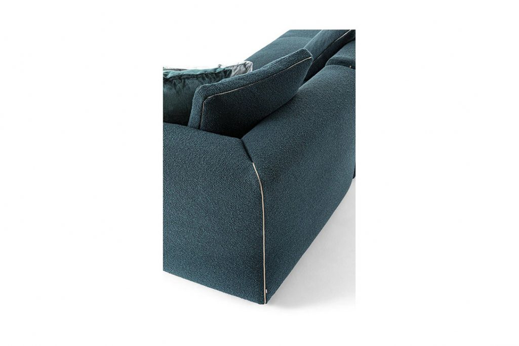 detail of corner of cassina dress-up sofa on a white background
