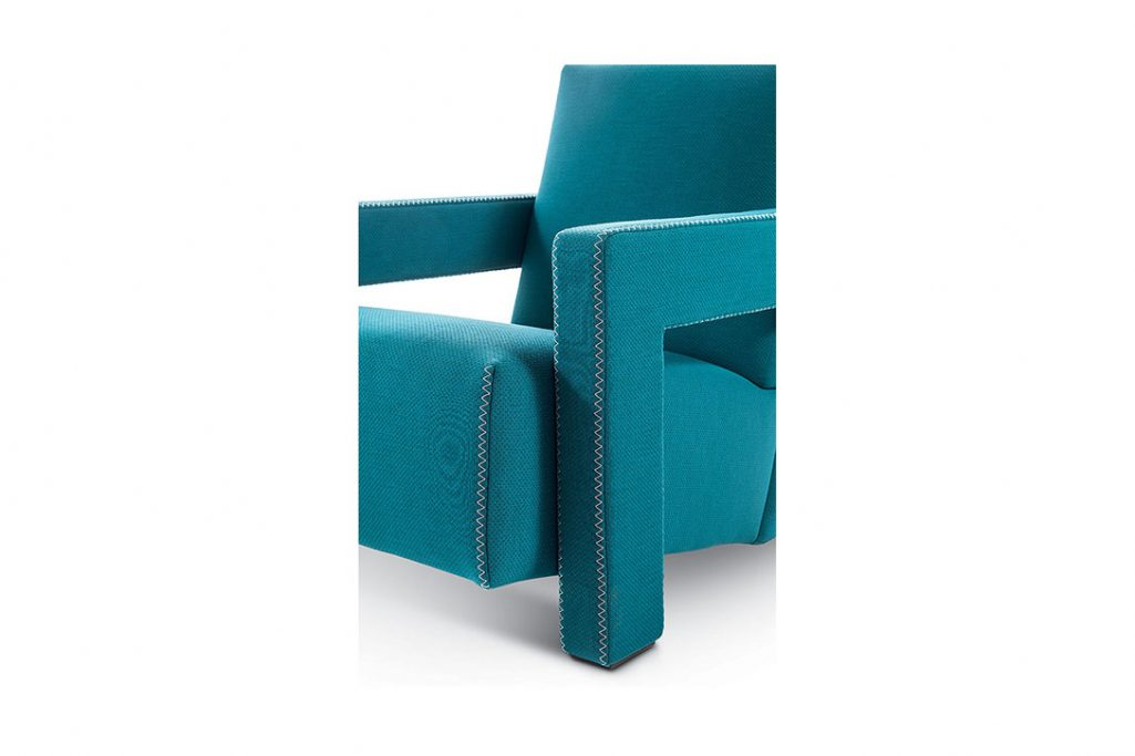 close up of zig zag stitch on a cassina utrecht armchair on a white background