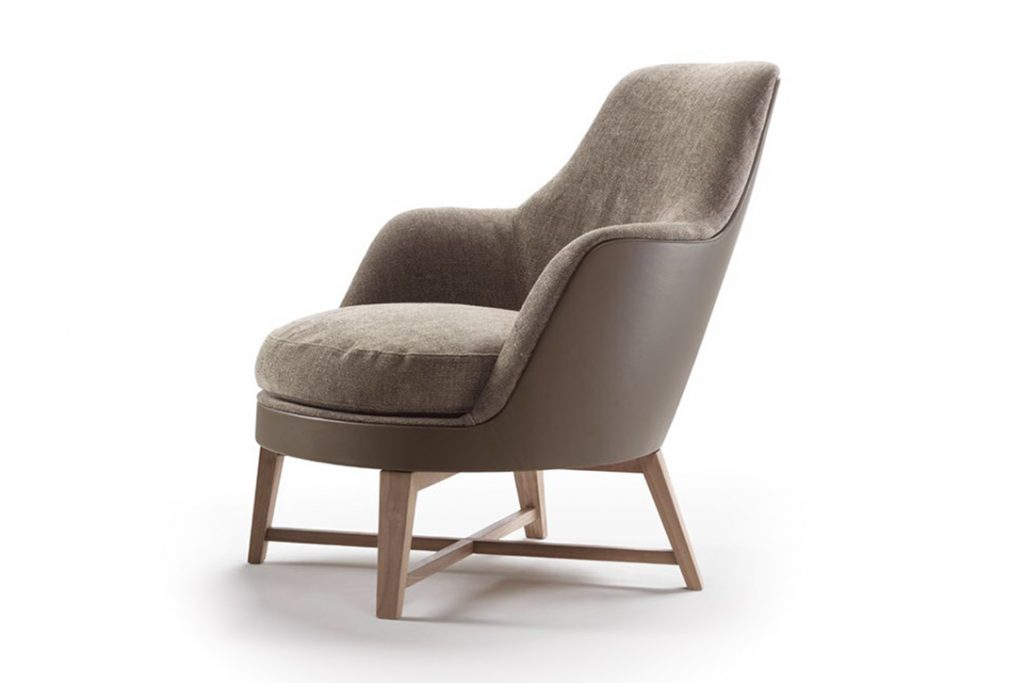 flexform guscio armchair with wood base on a white background