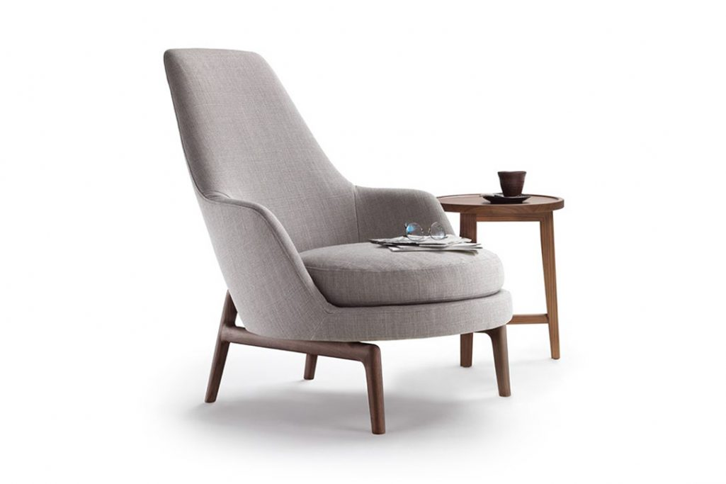 flexform leda armchair high back and side table on a white background
