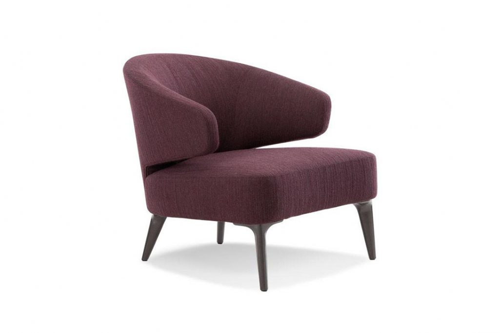 minotti aston armchair on a white background