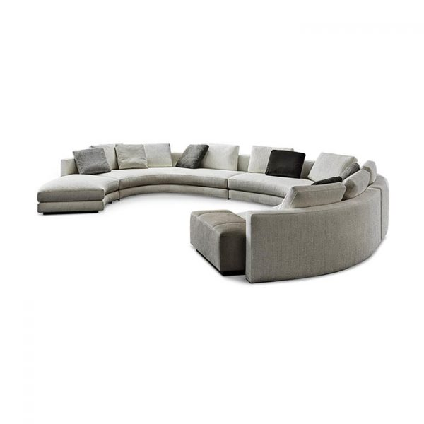 curved minotti daniels sofa on a white background