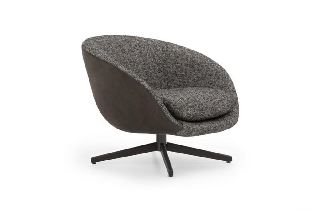 minotti russell armchair swivel on a white background