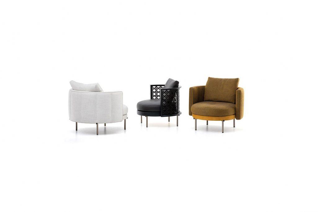 three minotti torii armchairs on a white background
