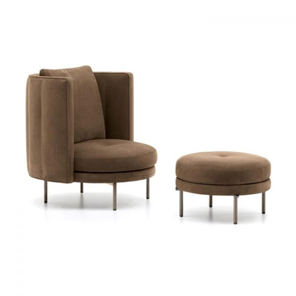 minotti torii armchair and ottoman on a white background