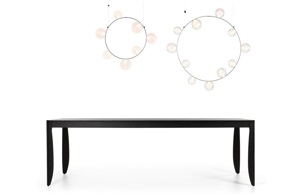 two moooi hubble bubble pendant lights hanging above a monster table on a white background