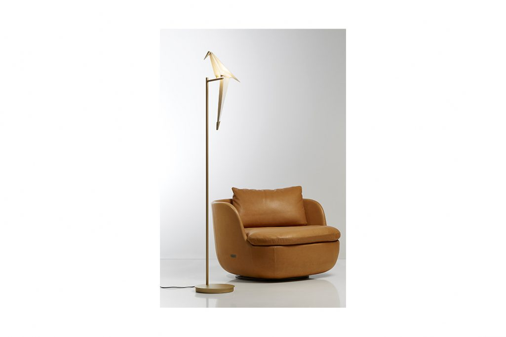 moooi perch light floor lamp next to a leather armchair