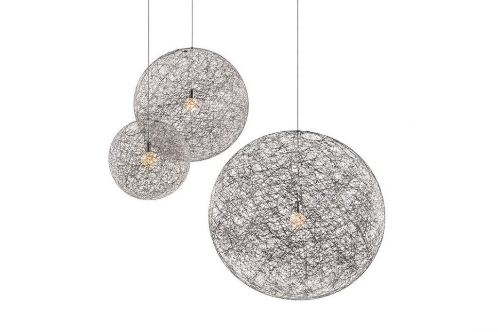 cluster of three black moooi random light II pendants on a white background