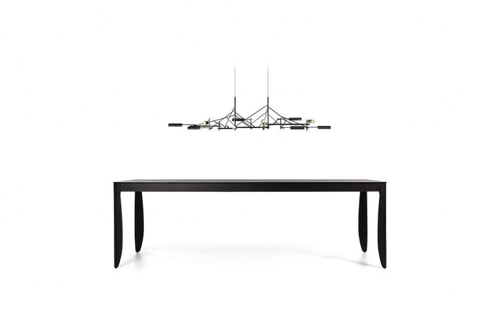 moooi tinkering pendant light 140 on a white background above a monster table