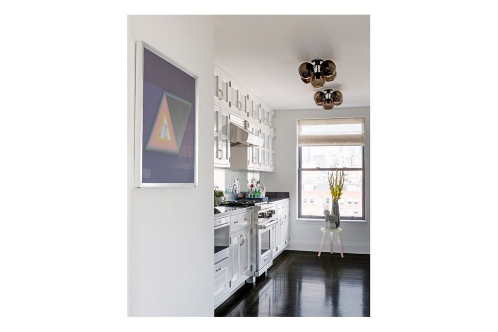 kitchen featuring roll and hill modo ceiling lights