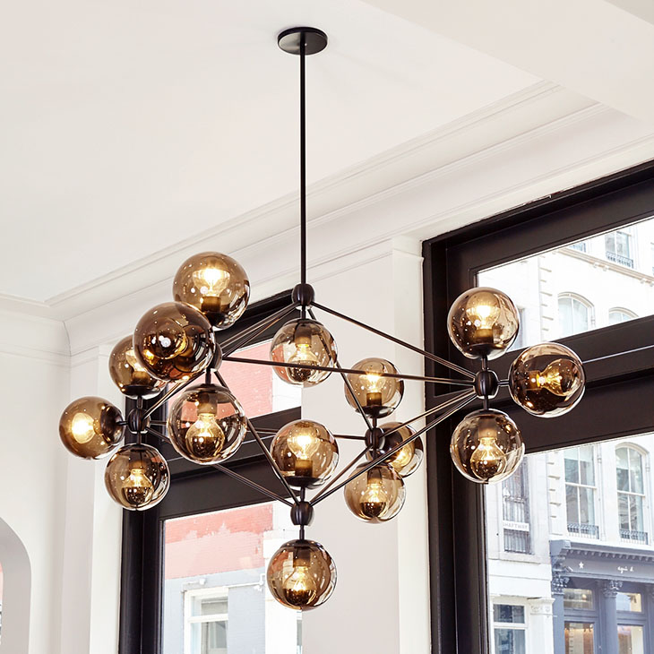 storefront featuring a roll and hill modo chandelier